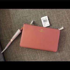 Coach pink big wristlet wallet